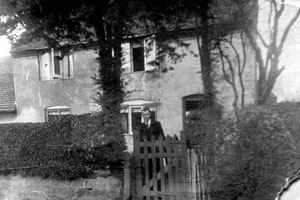 The Nailers Cottage with resident John Rounds 1931. Image 'All Rights Reserved' courtesy of Bernard Taylor of the Quinton Local History Society. See Acknowledgements to link to the website.