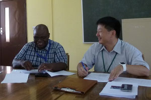 Prof. Aaron Mweene with our director, Prof. Okumura in 2016