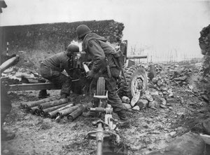 A US gun crew of the 254th Infantry Regiment manning a 57mm Anti Tank gun during the battle of Jebsheim.