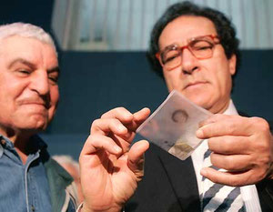 AP - Egypt's antiquities chief Zahi Hawass, left, and Culture Minister Farouk Hosni, right, examine 3,200-year-old hair sample from the pharaoh Ramses II.