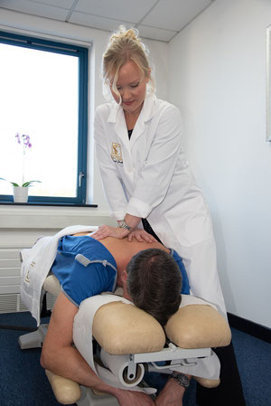 Patient under going a spine adjustment by Dr Sarah Parkes