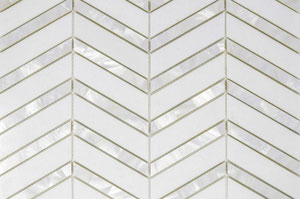 Chevron-pattern mosaic made of alternating white marble and white pearl stripes.