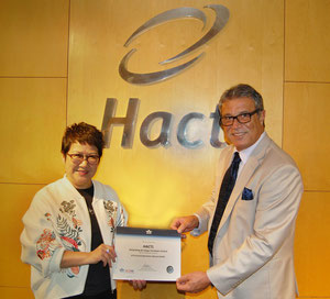 HACTL Finance Director Amy Lam receives the IGOM certificate from IATA Head of Ground Operations Joseph Suidan  -  courtesy: HACTL.