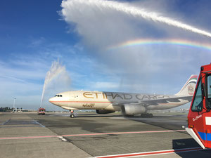 Etihad operated A330F gets a welcome shower at BRU  -  Photo BAC