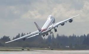 """Wing waving"" maneuver of 747-8F right after takeoff"