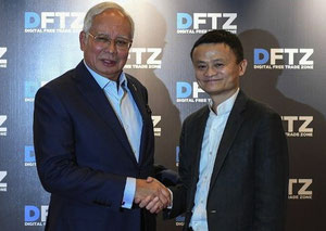 Alibaba's Jack Ma (right) with Malaysian PM Najib Razak