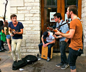 © Winifred. A passionate group of musicians who were busking at SXSW Music 2012.