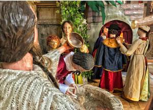 Jesus lädt im Hintergrund die künftigrn Jünger, die Johannes ihm geschickt hat, zum Nachmittagskaffee in sein Haus.