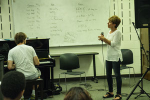 April Tini instructs vocal workshop class