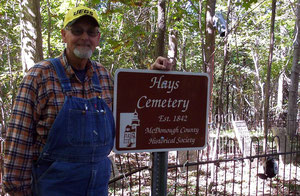 Gerald Thrapp accepts a new sign for the Hays Cemetery installed by the McDonough County Historical Society.