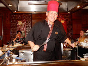 Our Chef at Teppanyaki Performs for his Dining Patrons
