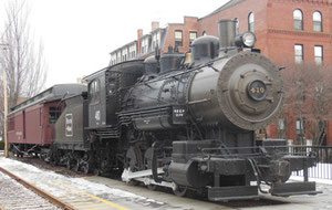 Old Engine and Railroad Cars on Exhibition