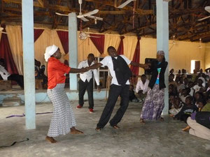 Students performing a drama in a local church
