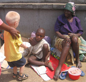 Elijah giving a meal to a young boy