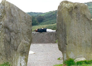 Kathy resting on 'Druid's Alter' in the Drombeg stone circle, three miles west of Ross Carbery, County Cork, Ireland.