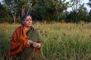 Vandana Shiva in front of a millet field, Navdania seed bank