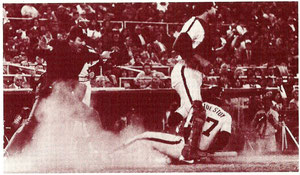 Bob Boone looks on helplessly as Rafael Landestoy scores what would become the winning run in the 10th inning.