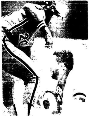 Bill Madlock slides under Mike Schmidt's tag to steal third base.