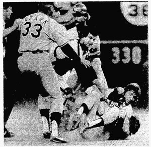 Bill Russell goes after Tug McGraw after being hit by a pitch in the 9th inning.