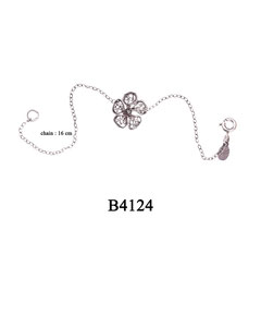 B4124 OXI 45, GP 55: OXI BRACELET W/ FILIGREE FLOWER IN CENTER.