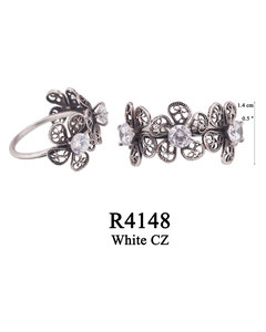 R4148 OXI 60, GP 70: OXI RING 3 FILIGREE FLOWERS IN A ROW W/ WHITE CZ IN CENTER OF EACH FLOWER.