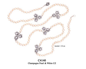 C4140 OXI 225, GP 270: OXI TWIST NECKLACE CHAMPAGNE PEARL, 5 BUNCHES OF FILIGREE FLOWERS W/ 3 WHITE CZ IN EACH FLOWER.