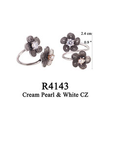 R4143 OXI 60, GP 70: OXI RING 2 FILIGREE FLOWERS 1 W/WHITE CZ IN CENTER, 1 W/ CREAM PEARL IN CENTER OF FLOWER.