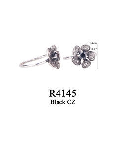 R4145 OXI 50, GP 56: OXI RING FILIGREE FLOWER W/ BLACK CZ IN CENTER OF FLOWER.