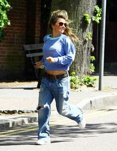 Gerri Halliwell jogging in Hampstead. London UK