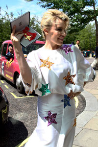 Kylie Minogue receiving her OBE. London UK