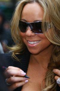 Mariah Carey signing for fans in London UK