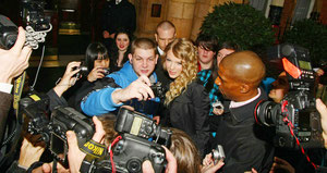 Taylor Swift signing autographs for fans London UK
