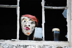 Tête et pinte de Guinness