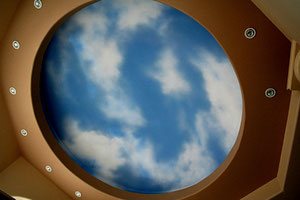 Airbrushed sky transforms a residential ceiling.