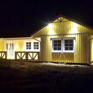 Referenzhaus Älmhult Holzhaus in gelb von Berg-Schwedenhaus