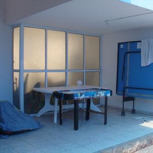 Espace de jeux, table de ping pong