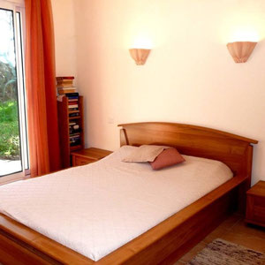 Traumferienhaus Bocca dell'Oro - Schlafzimmer mit großem französischen Bett