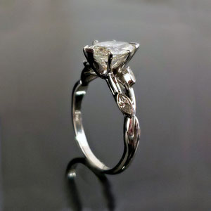 WF 35 - 14K white gold ring with marquise diamonds.