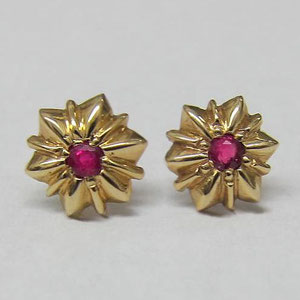 E 27 - 14K yellow gold earrings with bead set rubies.