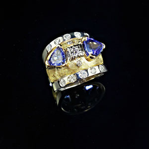 CS 60 - 18K yellow gold and platinum custom designed ring with diamonds and trillion cut tanzanite.