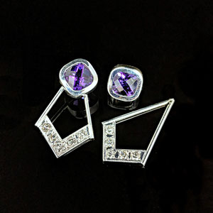"E101 - 14K white gold earrings with bezel set checkerboard cut amethyst. ""Jacket"" with bead set diamonds."