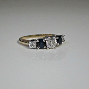 DF 24 - 14K two tone ring gold  with diamonds and sapphires.