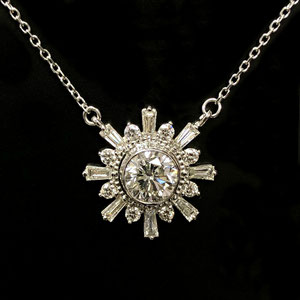 P 121 - 14 K white gold necklace with center bezel set diamond; baguette and round diamonds..