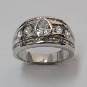 DF 18 - 14K white gold ring with center pear shaped diamond and channel set side diamonds.
