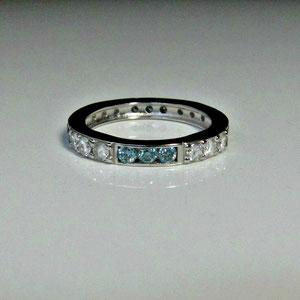 B 2 -  Platinum band with bead set white diamonds and channel set blue diamonds.