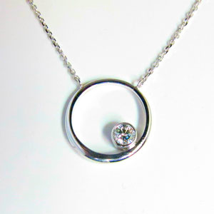 P 49 - 14k white gold necklace with a bezel set diamond.