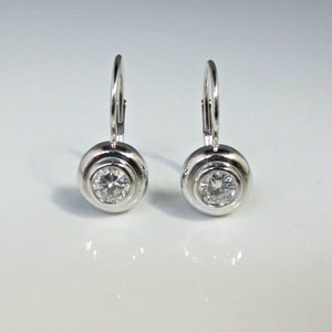E 38 - 14k white gold bezel set diamond earrings.