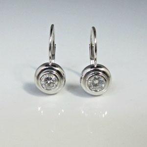 E 38 - 14k white gold bezel set diamond earrings.