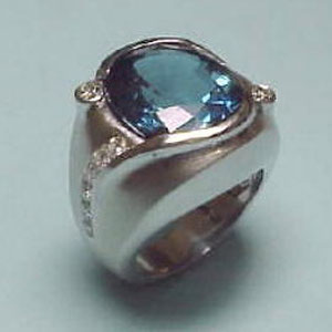 G 6 - 14K white gold ring with blue topaz and diamonds.