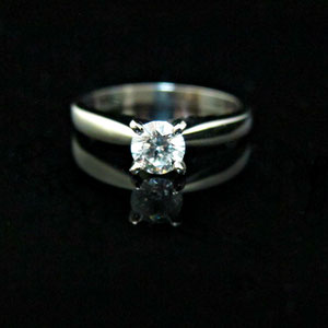 WF25 - Platinum 4 prong solitaire ring with diamond.